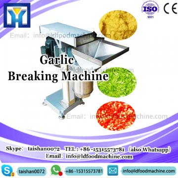 Automatic garlic clove breaking and peeling machine